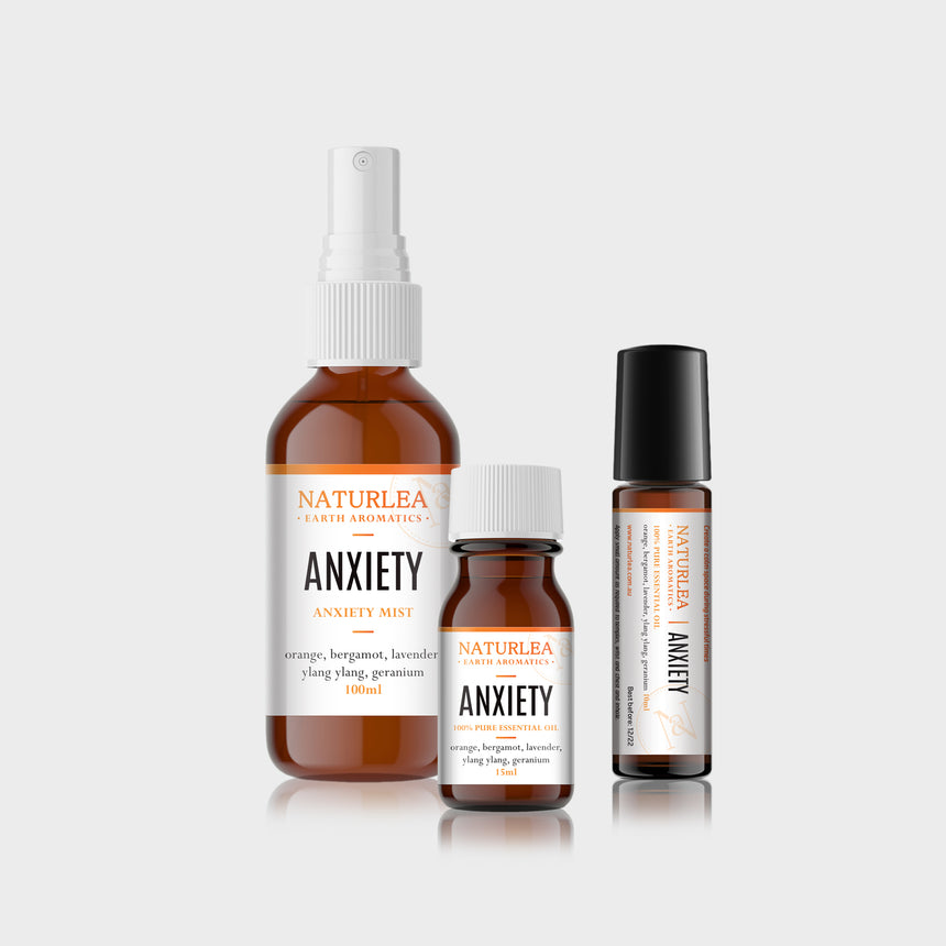 Naturlea Anxiety Mini Kit. Mist spray, essential oil bottle and roll on bottle grouped together. De-stress and unwind.