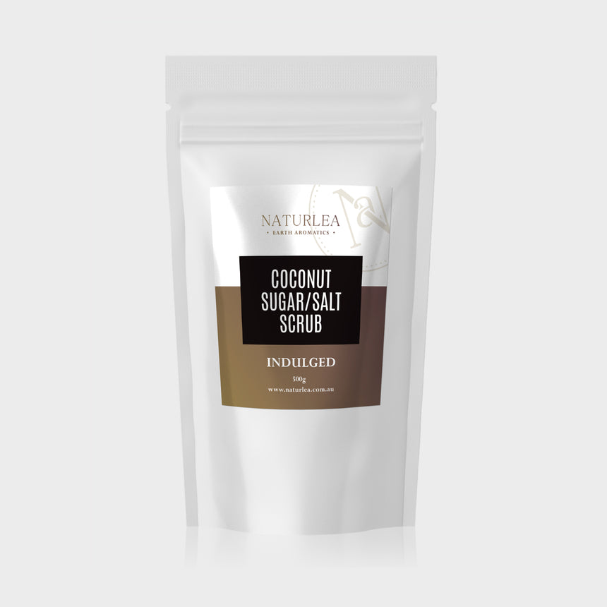 Naturlea Indulged Coconut Sugar and Salt Scrub 500g Pouch on Grey Background. Your time to rejuvenate. 100% Australian Made.