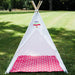 large white kids teepee with hot pink mat