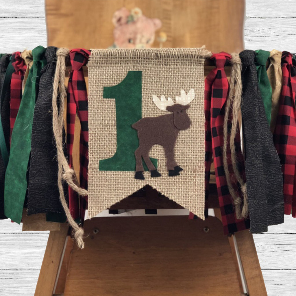 Outdoor woods themed high chair and teepee banner