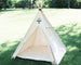 natural canvas teepee with a matching mat