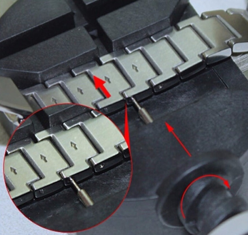 Arrows to remove the pin on the metal Apple Watch Band the correct way