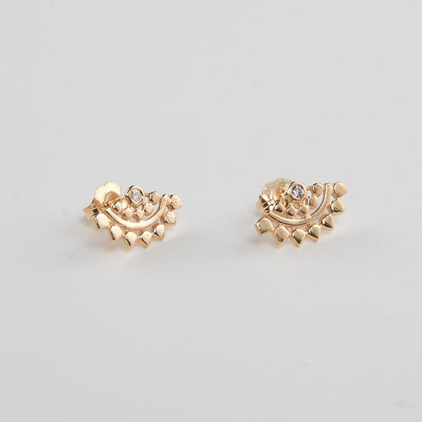 Pair of fan-shaped gold earrings with lace pattern, inset with small diamond.