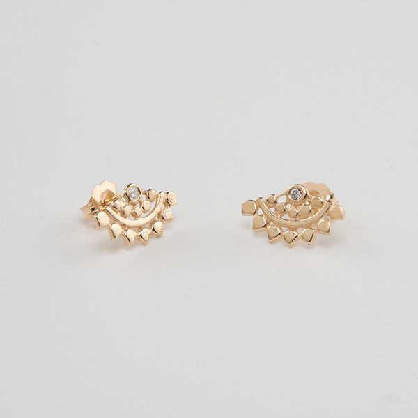 Pair of fan-shaped gold earrings with lace pattern, inset with small diamond, shown facing in.