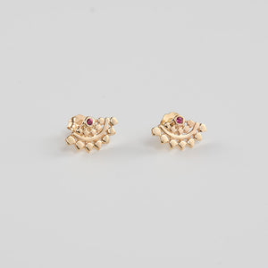 Pair of fan-shaped gold earrings with lace pattern, inset with small ruby.
