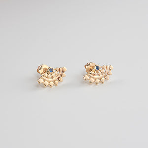 Pair of fan-shaped gold earrings with lace pattern, inset with small sapphire.