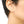 Load image into Gallery viewer, Close-up side view of woman wearing gold earrings, arc-shaped with little triangular beads.