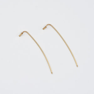 Pair of gold bar threader earrings with wire bar extending down.