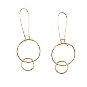 Pair of gold earrings with large and small interlocked circles on long earwire.