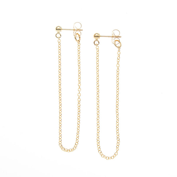 Pair of gold earrings, long loop of delicate chain on a post.