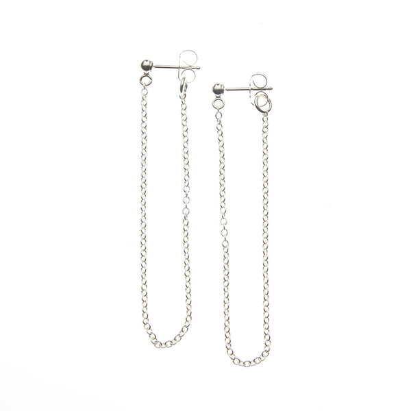 Pair of silver earrings, long loop of delicate chain on a post.