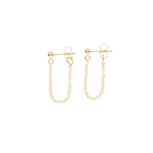 Pair of gold earrings, short loop of delicate chain on a post.