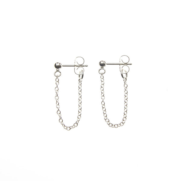 Pair of silver earrings, short loop of delicate chain on a post.