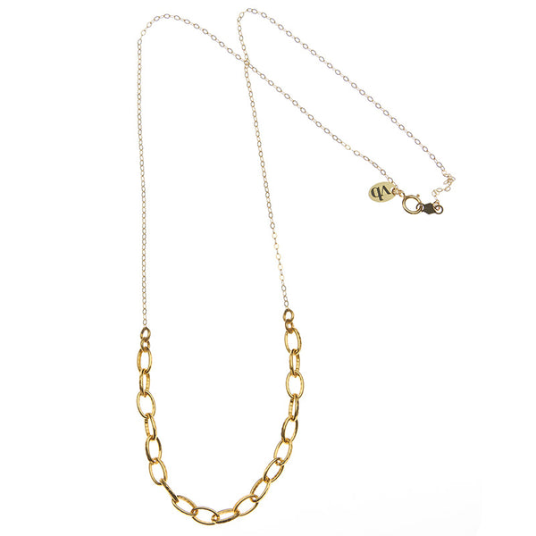 Gold necklace with delicate upper chain and thick gold link at bottom, full length showing clasp.