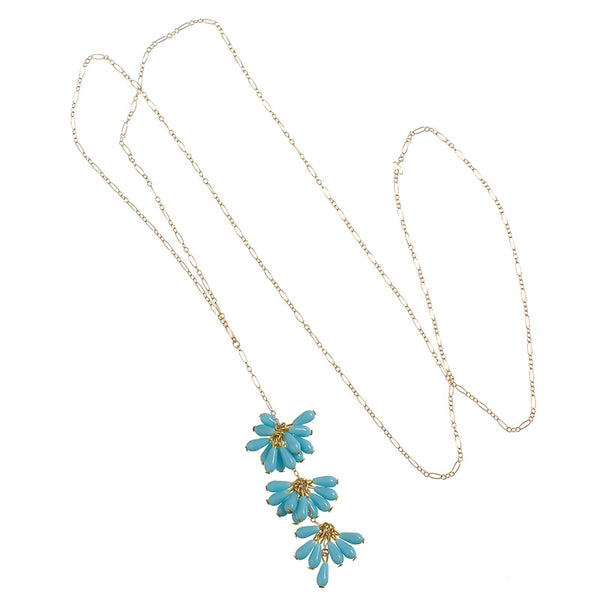 Delicate gold chain necklace with drop pendant of 3 bunches of turquoise beads with single bead at end.
