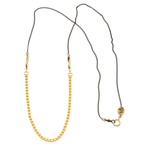 Necklace with black upper chain and gold box chain on the bottom, full length showing clasp.