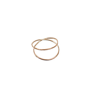 Gold ring with two loops of wire crossing.