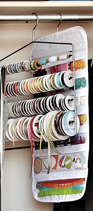 We love this idea of using a pant hanger to hold spools of ribbon. If you've got a closet to use for storage, this would be a great addition.