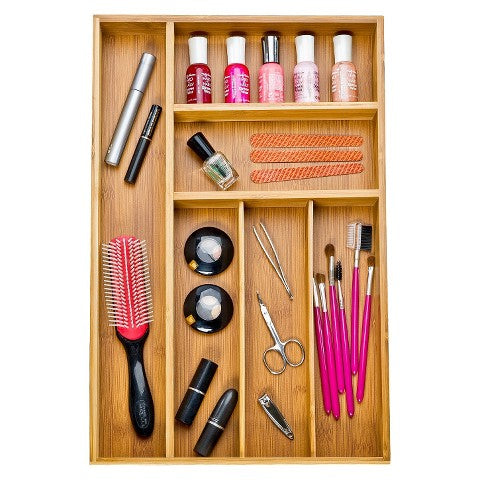 Drawer organizers are not just for your flatware anymore! Use one in your bathroom to keep your items separated but easy to find. The compartments are perfect for makeup or toothbrushes.