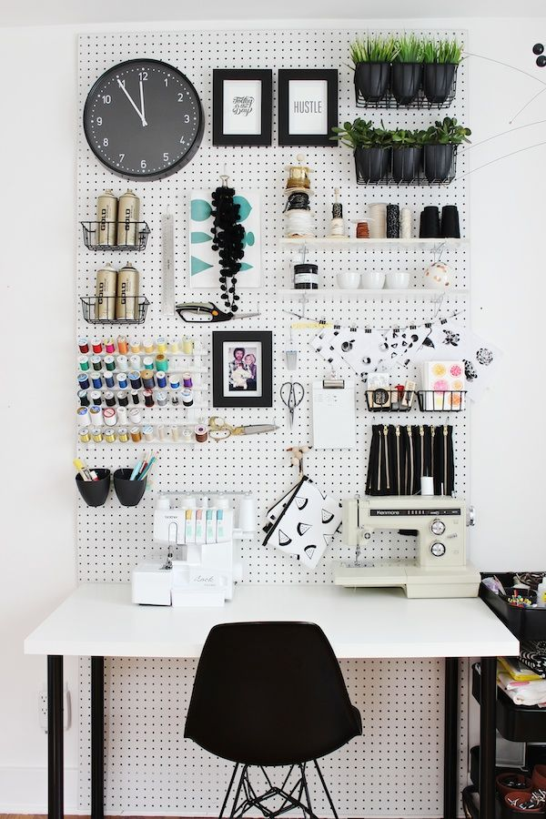 A pegboard is a great way to use a wall. You can add shelves, hooks etc. to make it work for your space. You can get them at your local home improvement store and a bit a paint can make it even more fun and exciting.