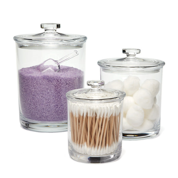 Glass containers are great for holding your more interesting items. Bath salts, q-tips, soaps and cotton balls are all great items for these canisters.