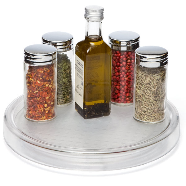 For those larger spices, oils, etc., a lazy susan tray is a great way to access all of the items quickly.