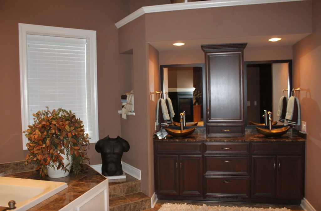 The beautiful brown walls, dark cabinets and decor make this bathroom feel rich and inviting.