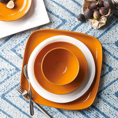 The Vietri Fantasia Orange Dinnerware Collection is part of our Tuscan Solid group and is characterized by its warm, saturated hue, deckled edge, and simple shape.