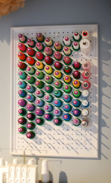 Another great use for a pegboard. Add some dowel rods and you can store your thread on your wall as well.