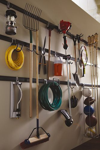We love this organizer. Move the hooks to where you need them, layer and store. This is a great way to hold all those tools that end up piled in the garage. Get them up and out of the way in no time and this makes it easy to keep them organized as well.