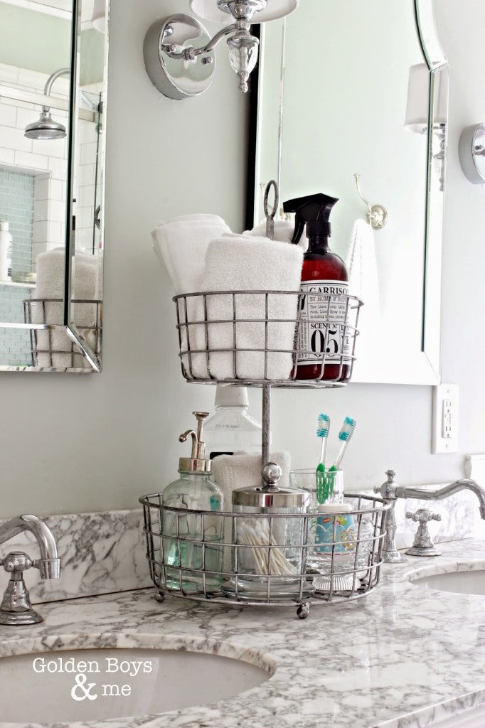 A beautiful wire organizer can work wonders on the bathroom counter. Store soaps, rags, toothbrushes, etc. It uses vertical space and can be a great eye-catcher as well.