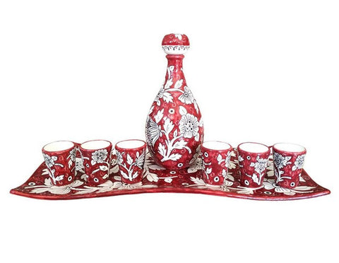 Limoncello Set with Floral and Red Decorations.