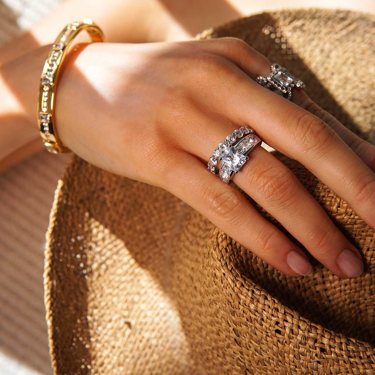 Abelstedt jewelry on hand holding a hat