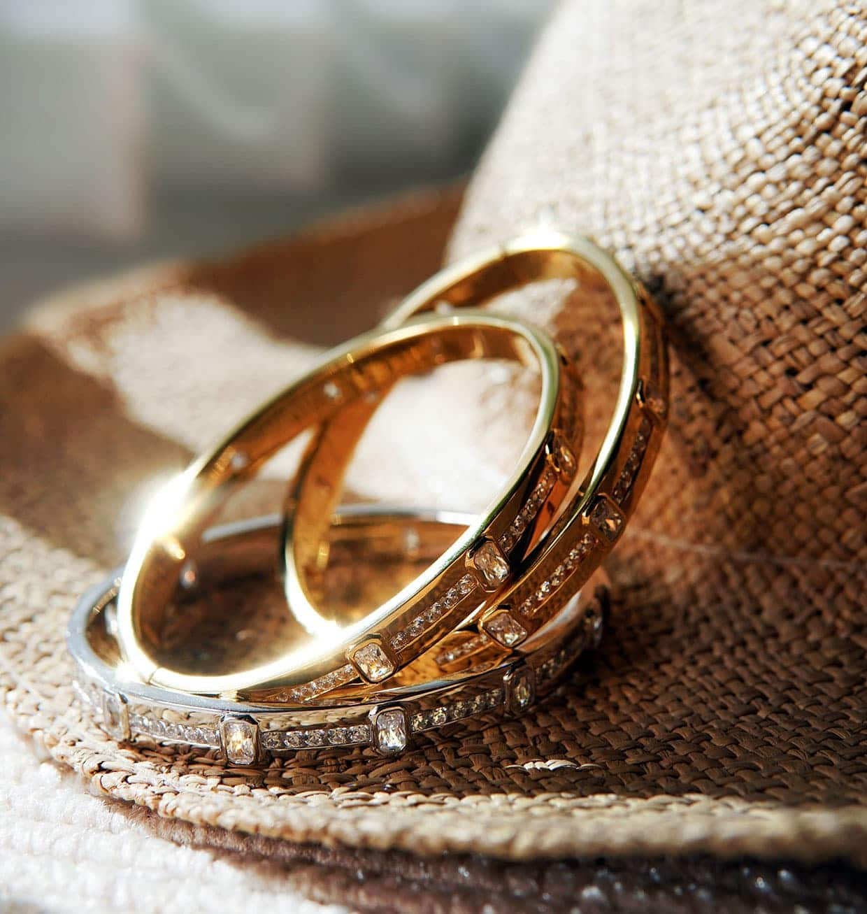 Abelstedt bangles stacked on a hat