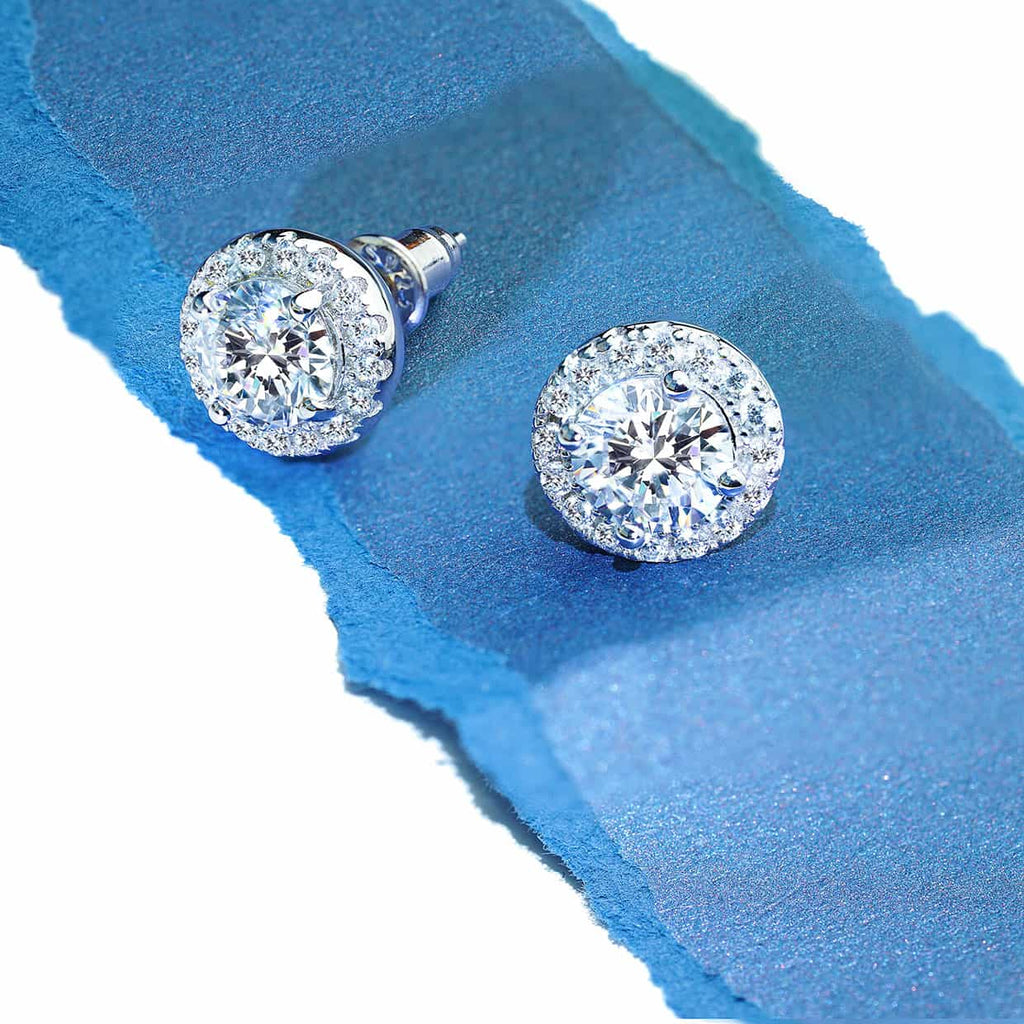 Oxford halo earrings on blue piece of paper