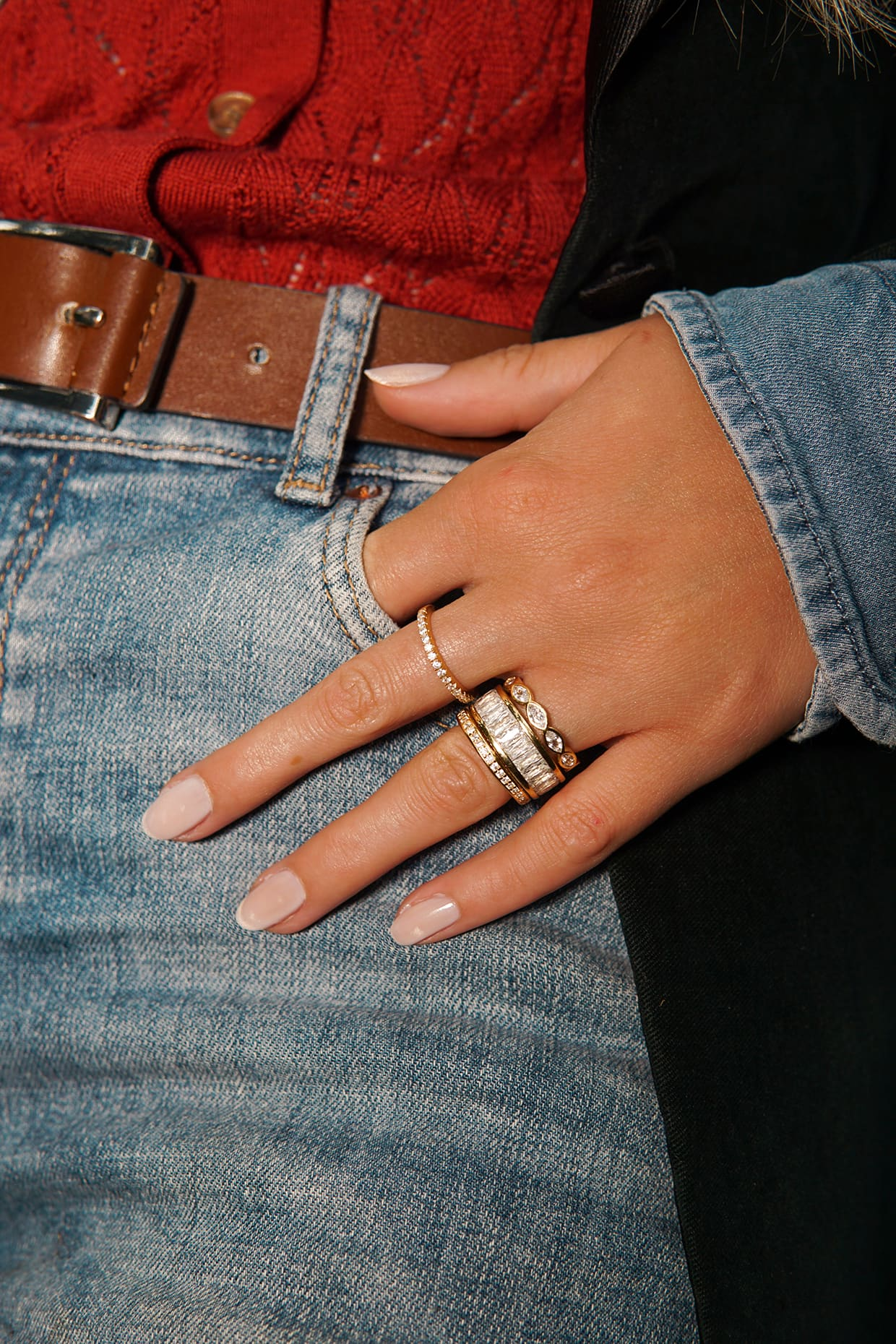 Rings on hand with jeans