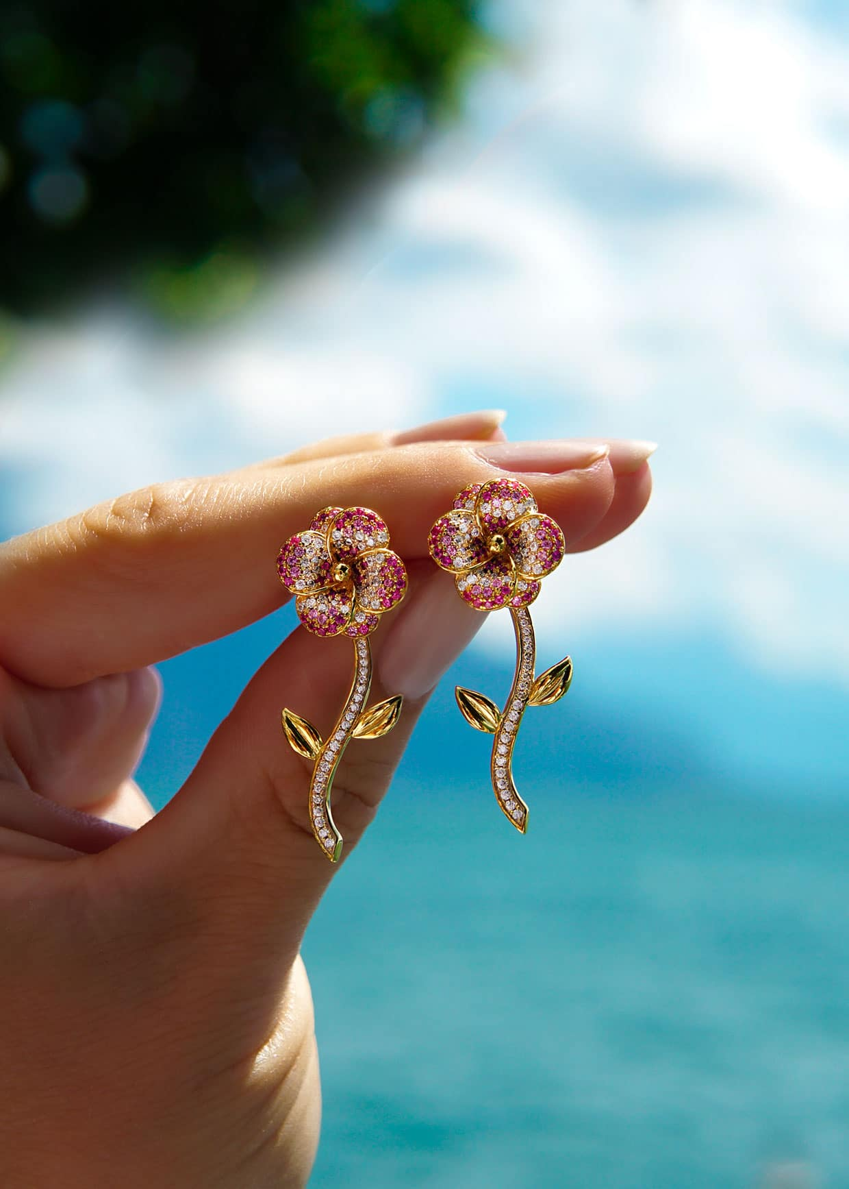 Flora earrings held up in the air
