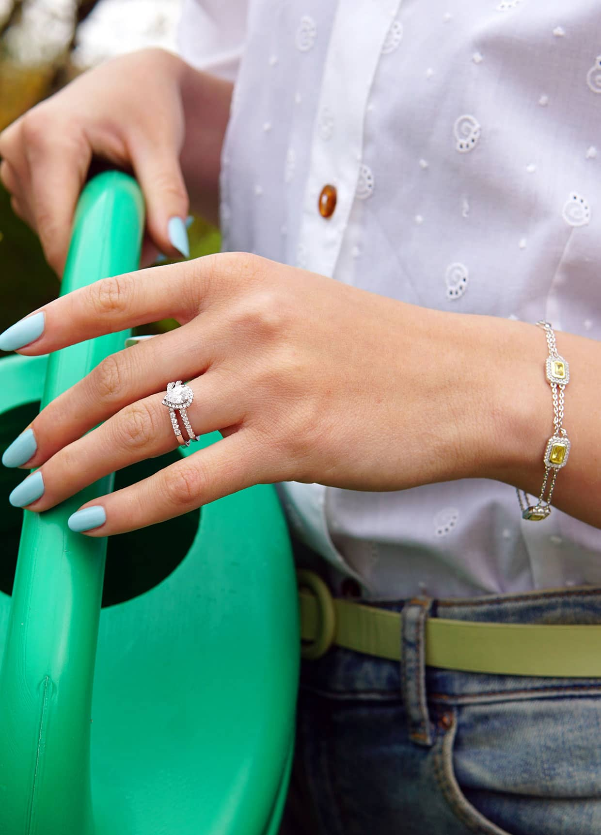 Julie Abelstedt with jewelry outdoors