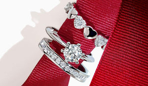 Rings on a red ribbon