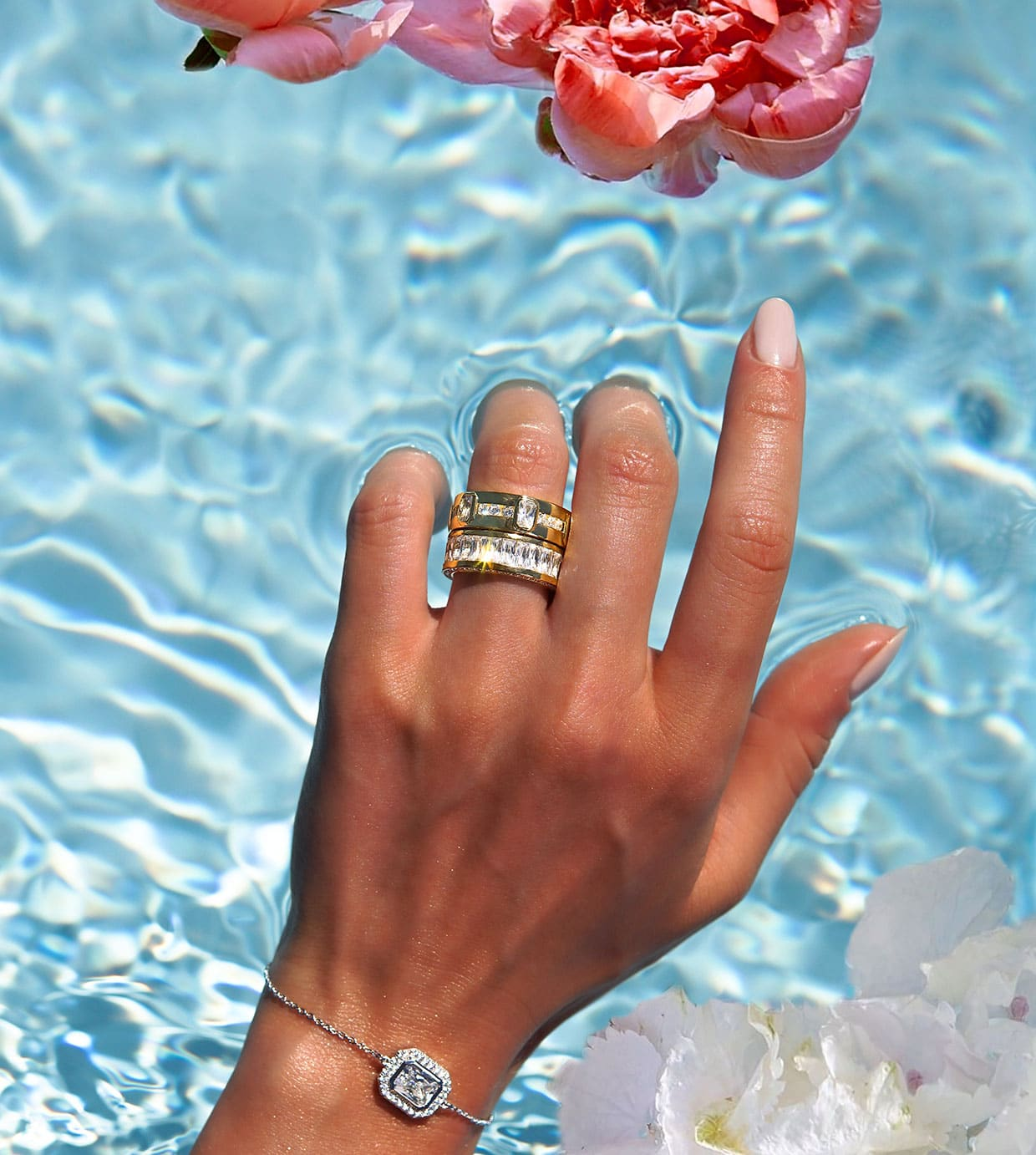 Rings on hand by the pool