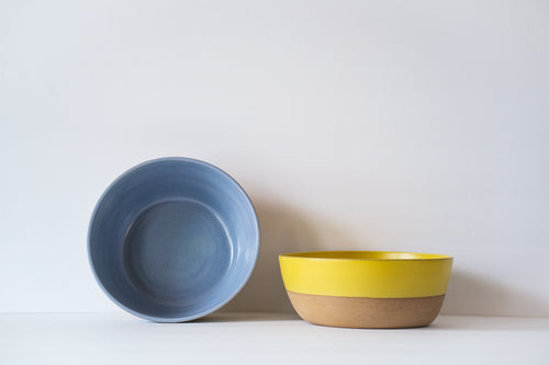 Yellow shallow bowl for pasta