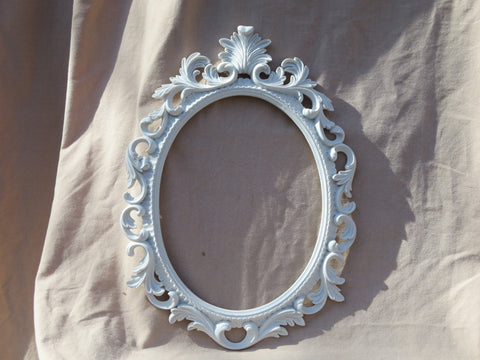 ornate heavy white resin oval frame