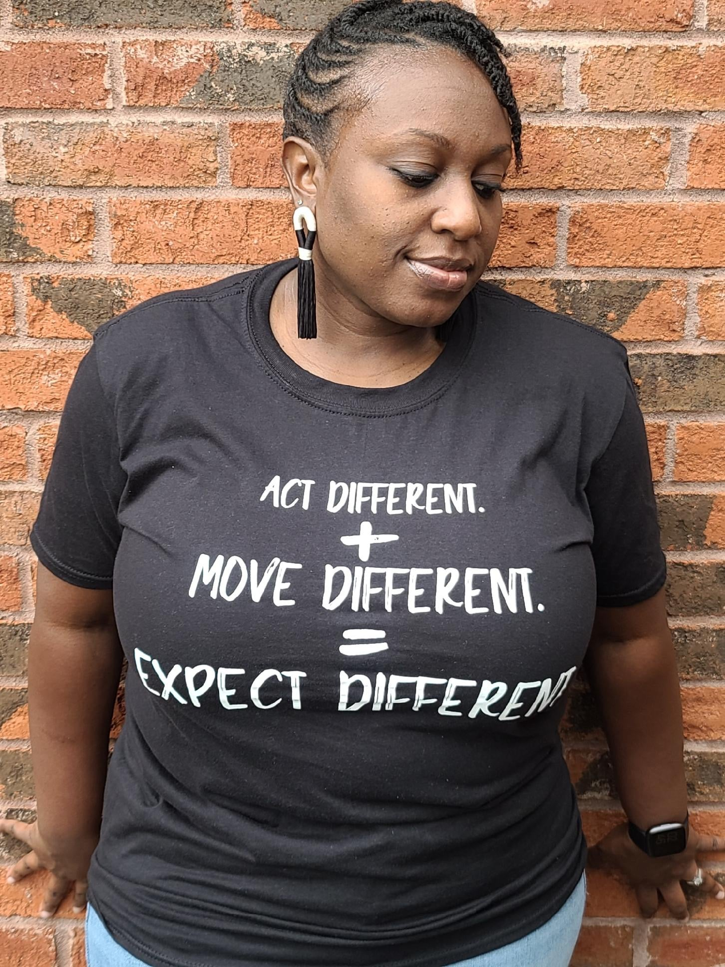 Act Different. + Move Different. = Expect Different. ™UNISEX Tee- Black
