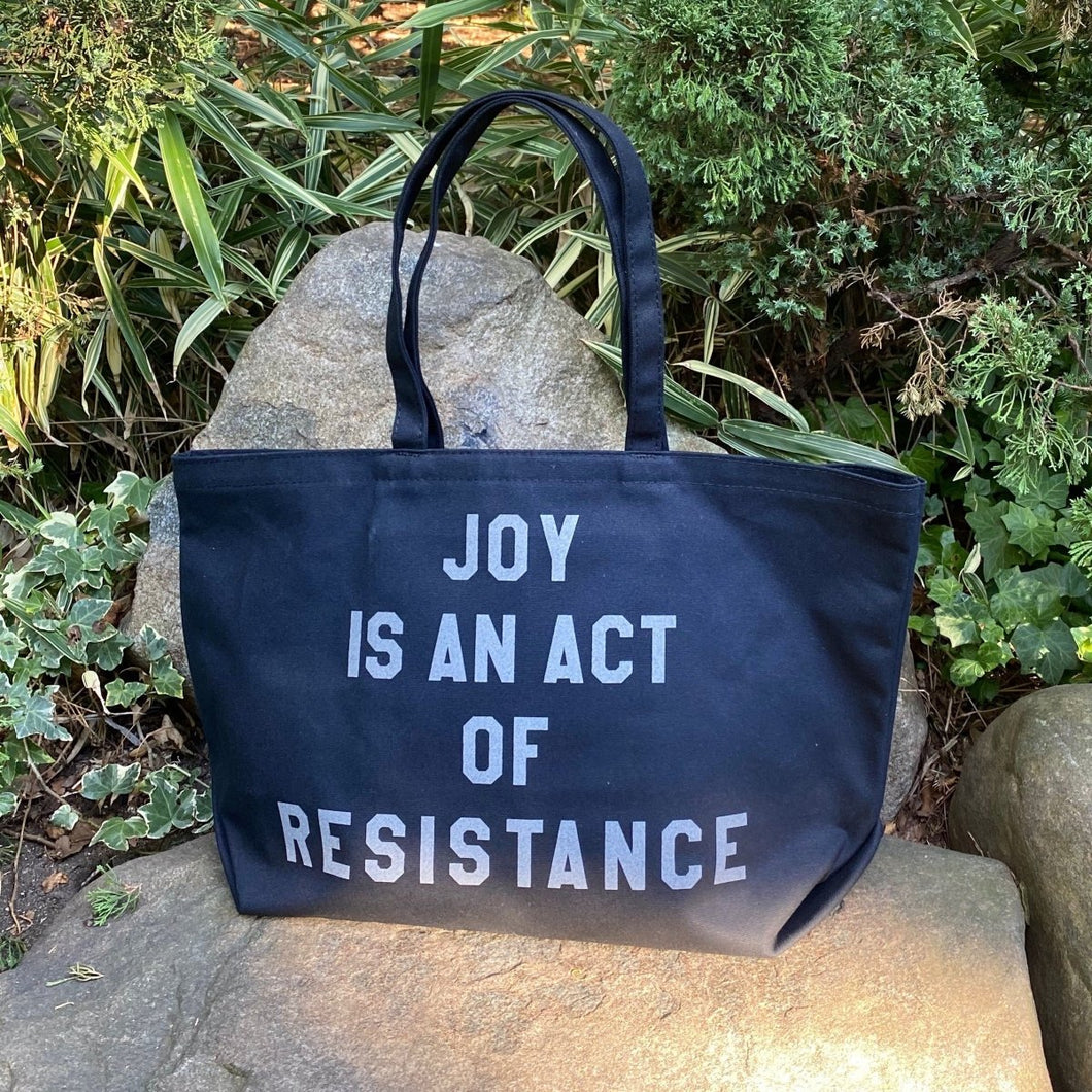 joy is an act of resistance tote with reflective letters by rayo & honey