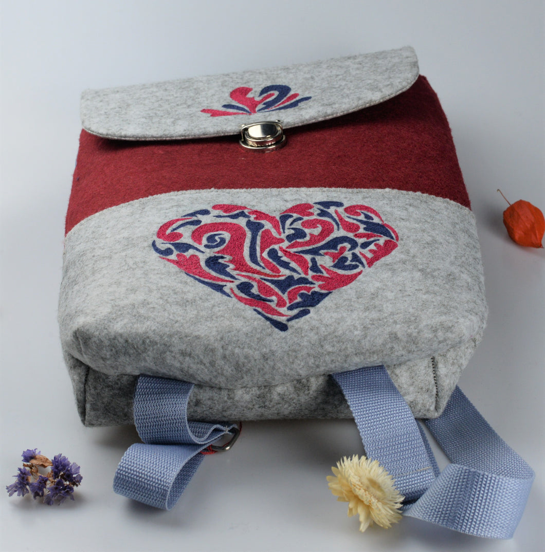 Backpack with traditionnal moravian patterns sewn