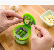 Load image into Gallery viewer, Press garlic chopper on both sides for home convenience
