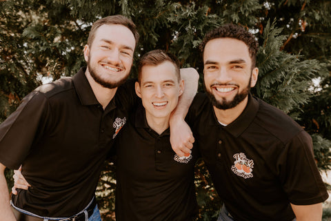 three smiling men who make up the peach brothers