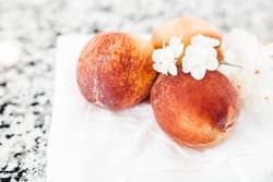 fresh peaches with white flowers