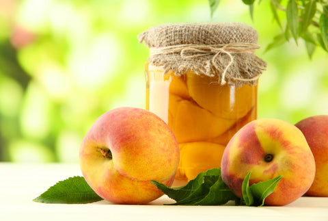canned fresh peaches with fresh peaches beside jar from the peach brothers