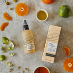 UpCircle face toner outside its package with orange and lime slices surrounding.